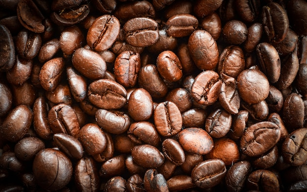 Coffee beans roasted coffee background top view coffee beans close up beautiful coffee tex