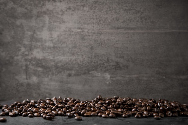 Coffee beans on rustic metal grey background