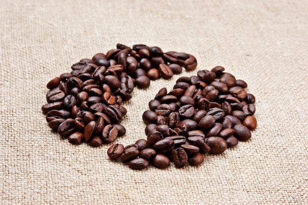 Coffee beans on a sack background