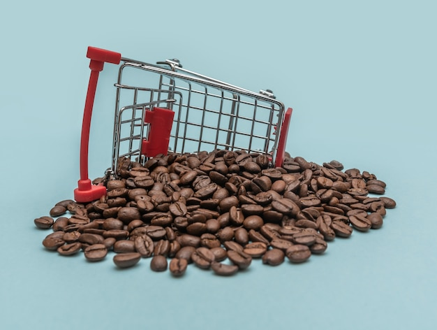 Coffee beans in a shopping basket. shopping. sale concept.