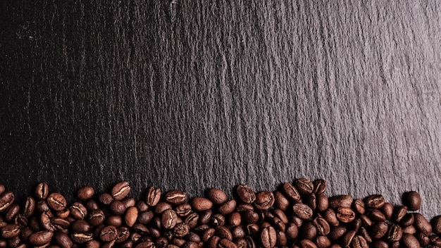 Coffee beans on a slate board. top view. copy space..