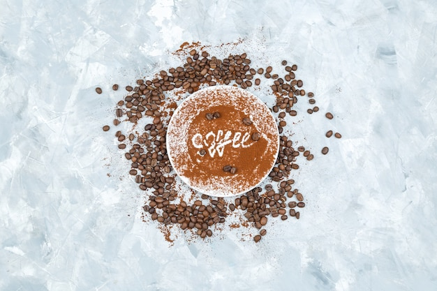 Coffee beans and spices on grunge background