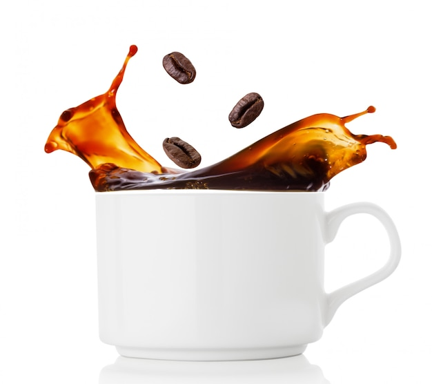 Coffee beans splash in cup of coffee