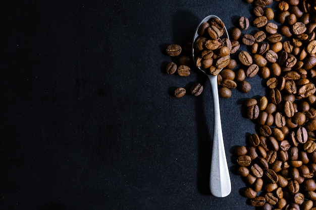 Coffee beans on spoon. top view. coffee concept.