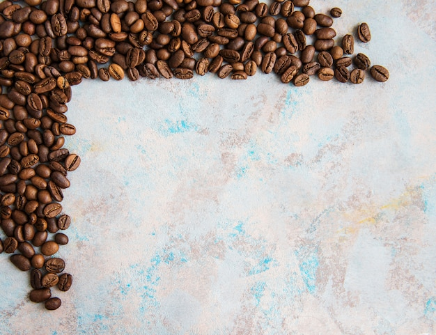 Coffee beans on a stone surface