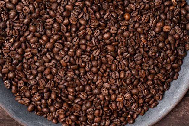 Кофе в зернах текстуры много