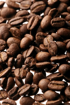 Coffee beans over white background