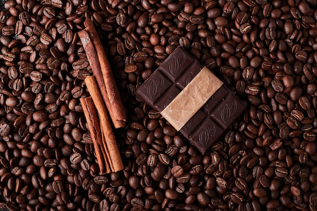Coffee beans with chocolate and cinnamons.