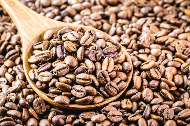 Coffee beans with wooden spoon, arabic coffee selected