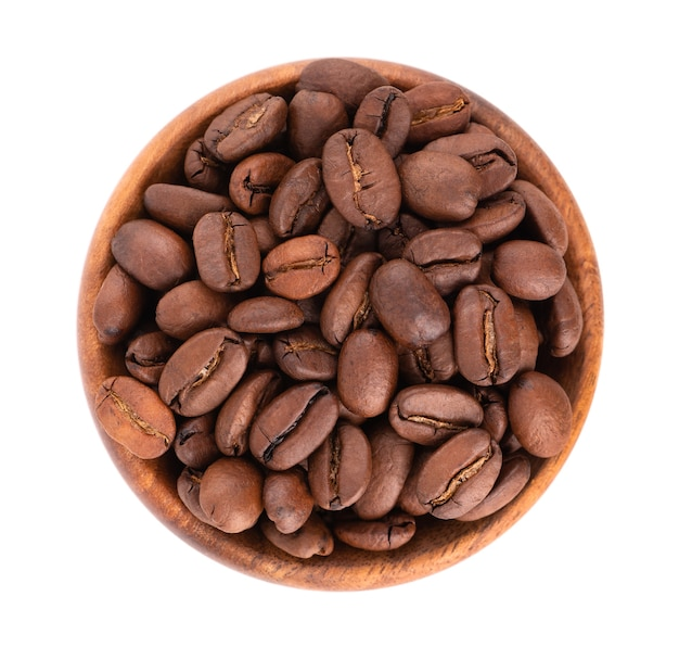 Coffee beans in wooden bowl isolated on white background. roasted arabica coffee beans. top view.