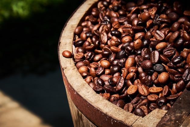Coffee beans in wooden bucket