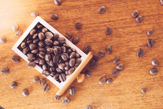 Coffee beans in wooden drawer close up
