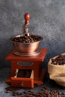 Coffee beans and a wooden grinder
