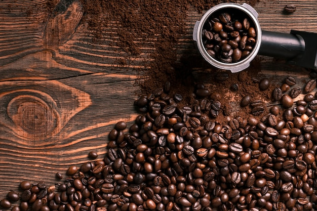Coffee beans on wooden table texture with copy space. view from above. still life. flat lay. mock-up