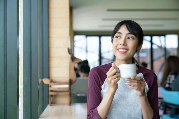 Coffee. beautiful girl drinking tea or coffee in cafe. beauty model woman