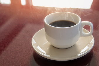 Coffee brake set, cups of hot coffee espresso on the table and light background