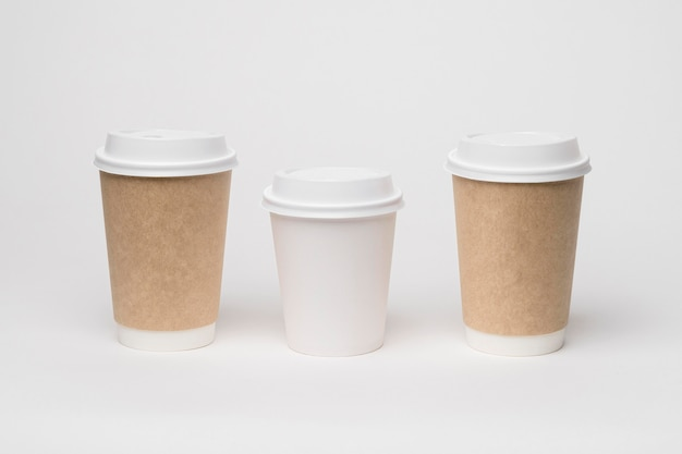Coffee branding with different cups high angle