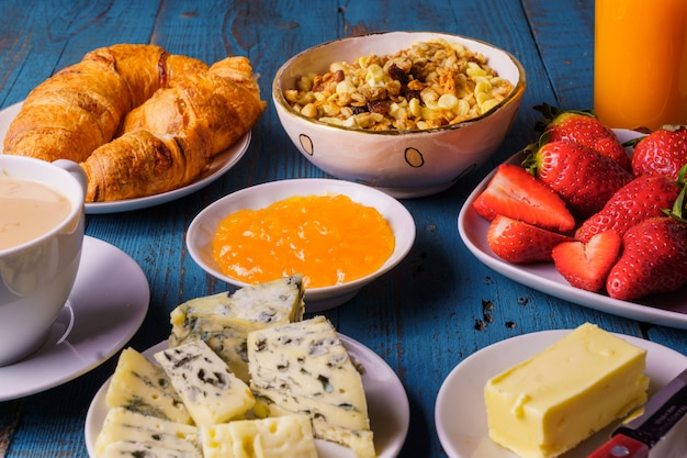 Coffee, bread, cheese and fruits for healthy breakfast.