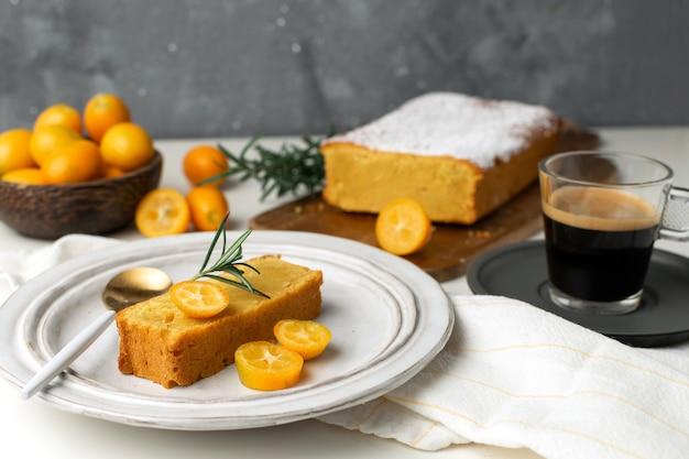Coffee break, homemade bakery - orange cake with kumquats