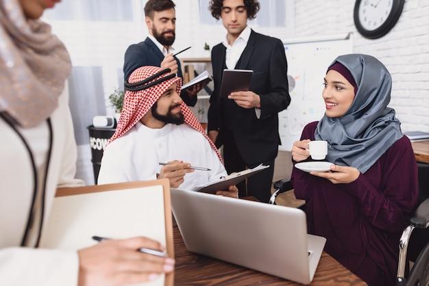 Coffee break in office happy arab people talk.