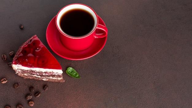 Coffee next to cake close up