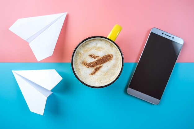 Coffee cappuccino with a picture of the airplane on the foam, top view.