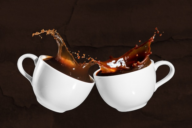 Coffee cheers with splash effect on brown stony background