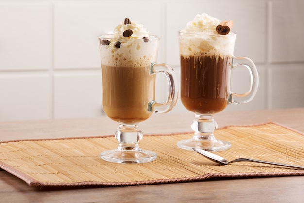 Coffee cocktails decorated with cream and cinnamon