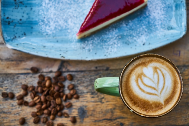 Coffee, coffee beans and cheesecake on a table