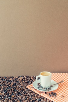 Coffee composition with cup on cloth