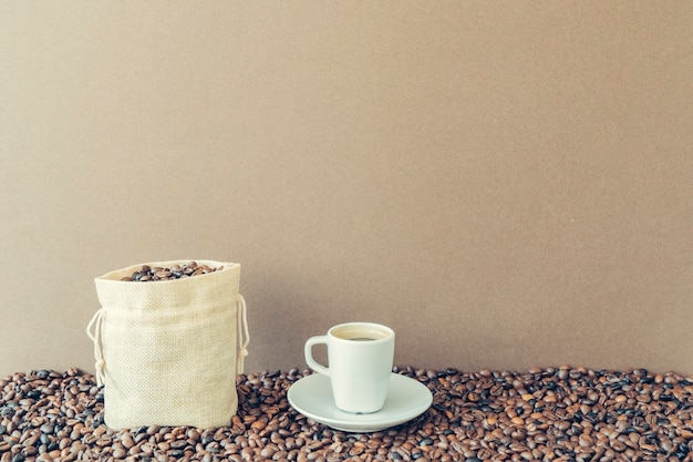 Coffee concept with bag next to cup