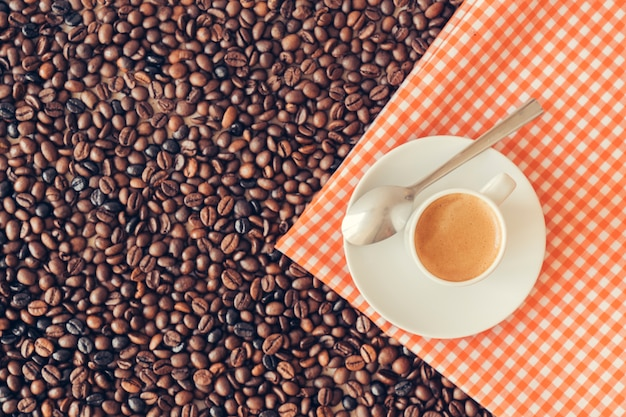 Coffee concept with coffee cup on cloth
