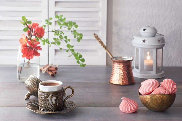 Coffee cooked in traditional turkish copper coffee pot and  served in metal ceramic cup Premium Photo