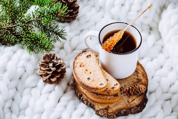 Coffee and cookies on a white blanket.
