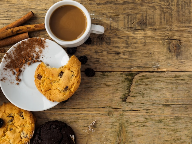 Coffee and cookies on a wooden table