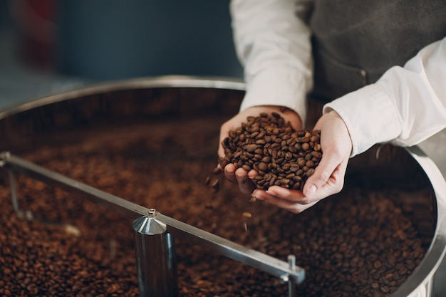 Coffee cooling in roaster machine at coffee roasting process.