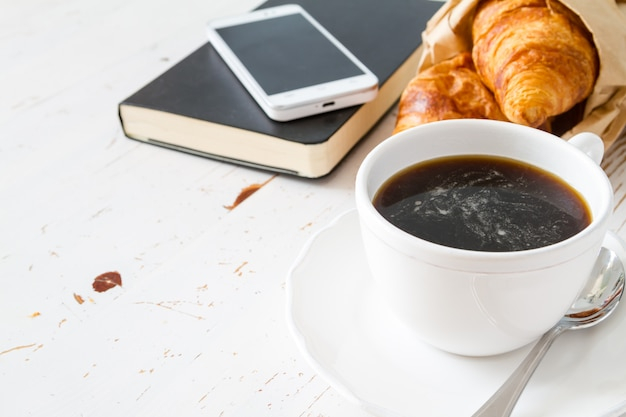 Coffee, croissants in paper bag