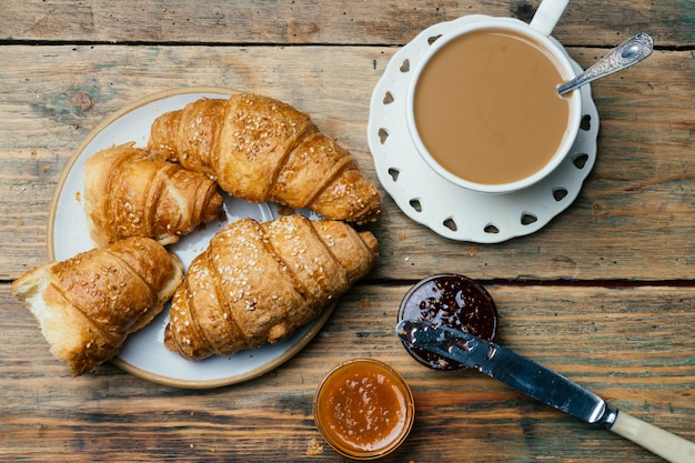 Coffee and croissants with jam. typical french breakfast (petit déjeuner)