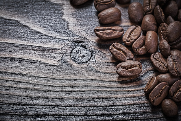Coffee crops on vintage wood board food and drink concept