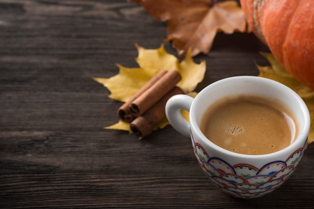 Coffee cup on autumn leaves