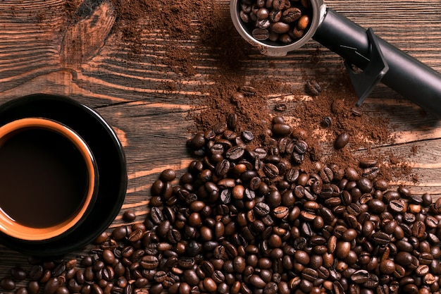 Coffee cup and beans frame on wooden table. top view. copy space. still life. mock-up. flat lay