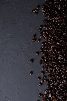 Coffee cup and beans on old grey kitchen beton background
