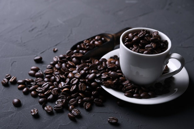 Coffee cup and beans on old grey kitchen  , rock table. top view with copyspace for a your text