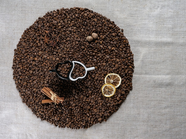 Coffee cup and beans on old kitchen table. top view.