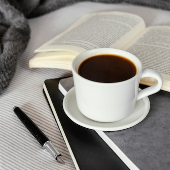Coffee cup and book high angle
