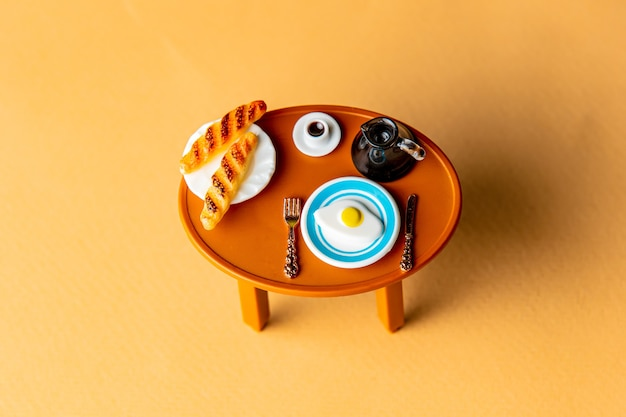Coffee cup and buns with eggs on a table