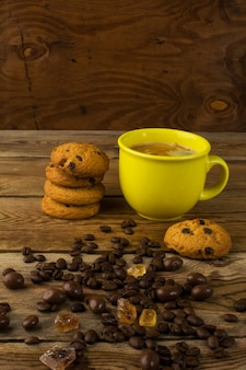 Coffee cup and chocolate cookie, vertical