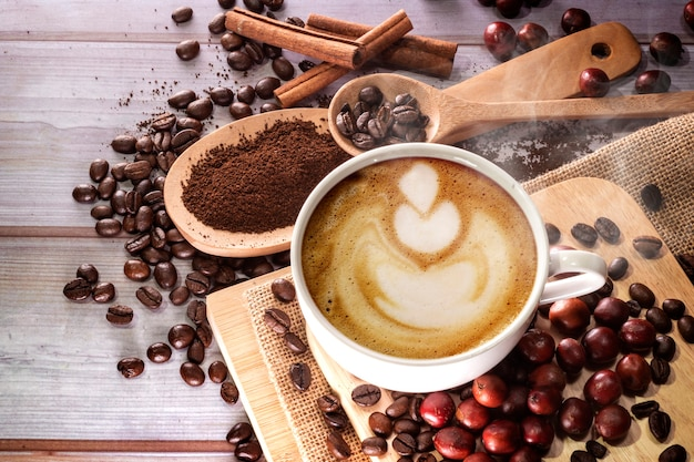 Coffee cup and coffee beanes Premium Photo