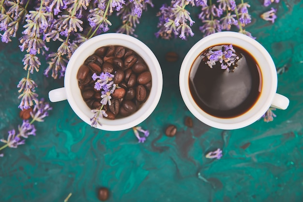 Coffee cup, coffee beans, and lavender flowers