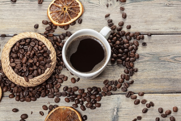 Coffee cup and coffee beans on wooden.